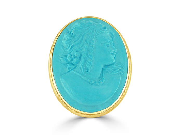 Oval turquoise cameo brooch in 18k yellow gold.