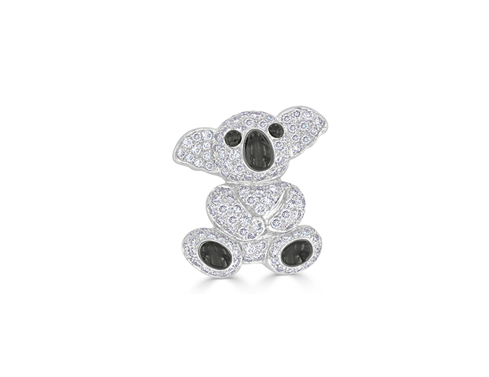 Black onyx and round brilliant cut diamond koala bear brooch.