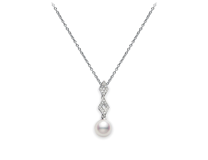 Mikimoto pearl and round brilliant cut diamond pendant in 18k white gold.