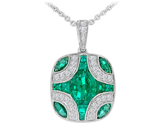 Oval emerald, multi-fancy shape emerald and round brilliant cut diamond pendant in 18k white gold.