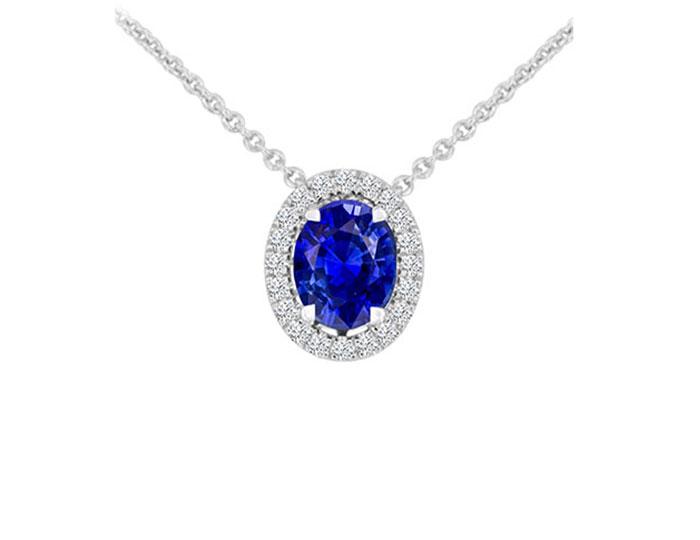 Oval sapphire and round brilliant cut diamond pendant in 18k white gold.