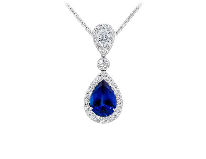 Pear shape sapphire, pear shape diamond and round brilliant cut diamond pendant in 18k white gold.