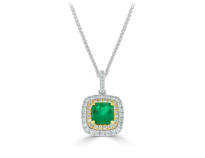 Cushion cut emerald and round brilliant cut diamond pendant in 18k yellow and white gold.