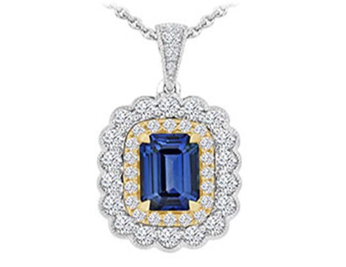 Emerald cut sapphire and round brilliant cut diamond pendant in 18k white and yellow gold.