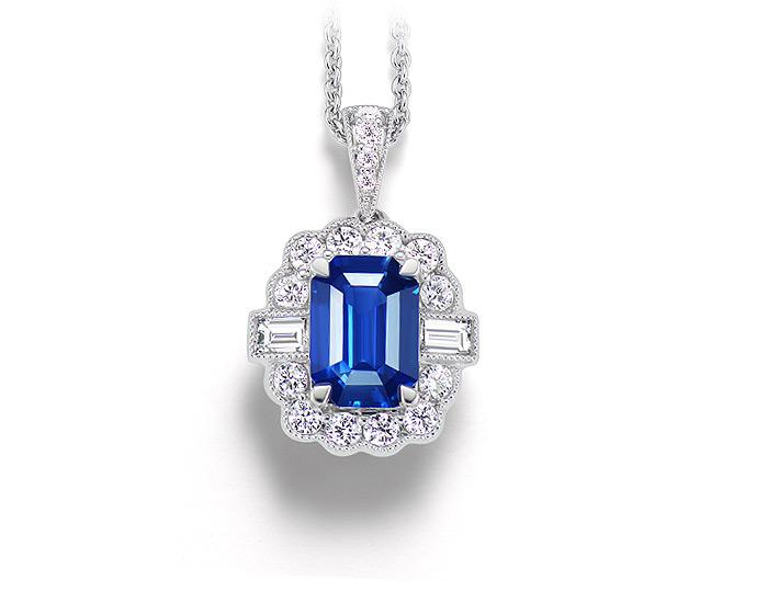 Emerald cut sapphire, baguette cut diamond and round brilliant cut diamond pendant in 18k white gold.