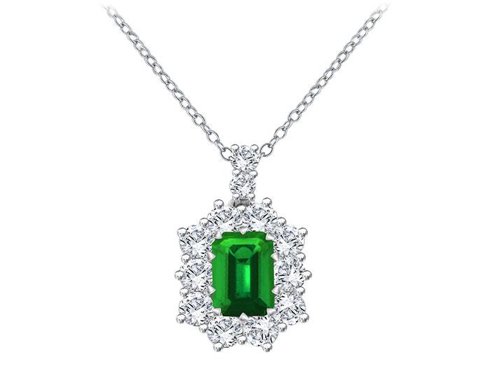 Emerald and round brilliant cut diamond pendant in 18k white gold.