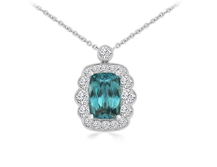 Cushion cut blue zircon and round brilliant cut diamond pendant in 18k white gold.
