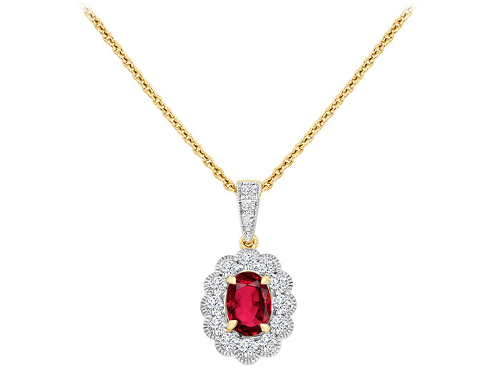 Oval shape ruby and round brilliant cut diamond pendant in 18k yellow gold.
