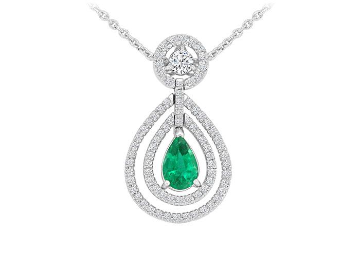 Pear shape emerald and round brilliant cut diamond pendant in 18k white gold.