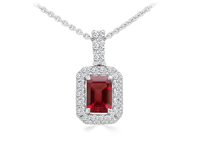 Emerald cut ruby and round brilliant cut diamond pendant in 18k white gold.