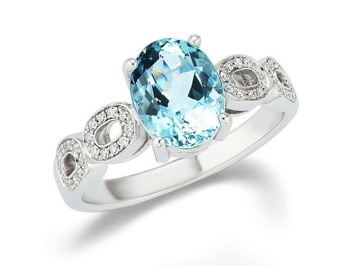 Aquamarine and round brilliant cut diamond ring in 18k white gold.