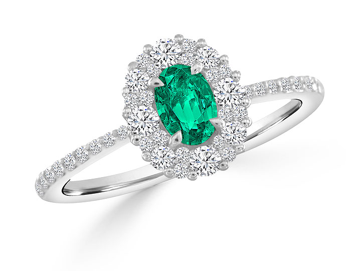 Oval emerald and round brilliant cut diamond ring in 18k white gold.