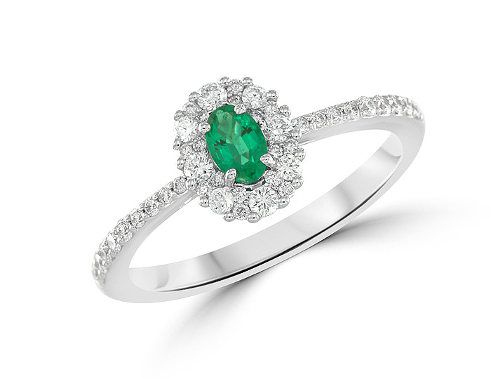 Oval shape emerald and round brilliant cut diamond ring in 18k white gold.