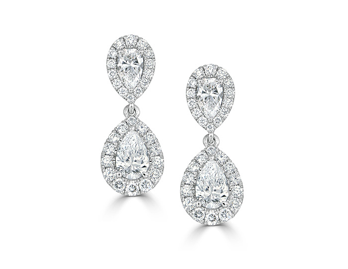 Pear shape diamond and round brilliant cut diamond earrings in 18k white gold.