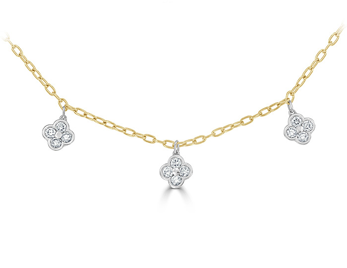 Round brilliant cut diamond necklace in 18k yellow and white gold.