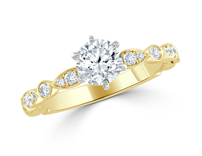 Round brilliant cut diamond engagement ring in 18k yellow gold.