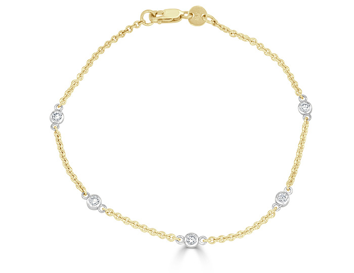 Round brilliant cut diamond bracelet in 18k yellow and white gold.