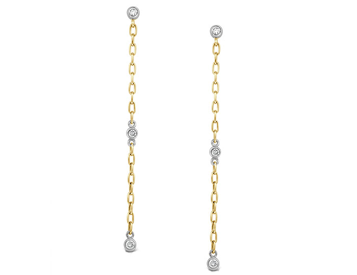 Round brilliant cut diamond bezel earrings in 18k yellow and white gold.
