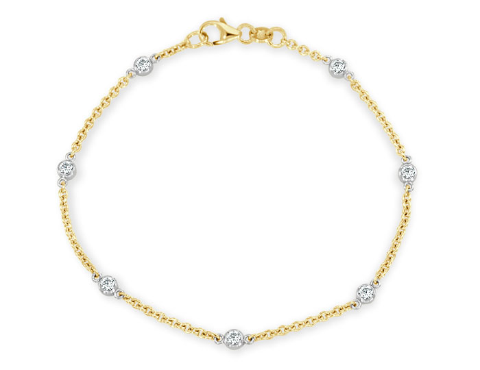 Round brilliant cut diamond bezel bracelet in 18k yellow gold.