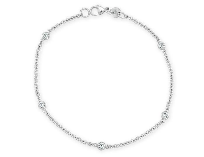 Round brilliant cut diamond bezel bracelet in 18k white gold.