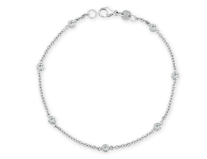 Round brilliant cut diamond bezel bracelet in 18k white gold.