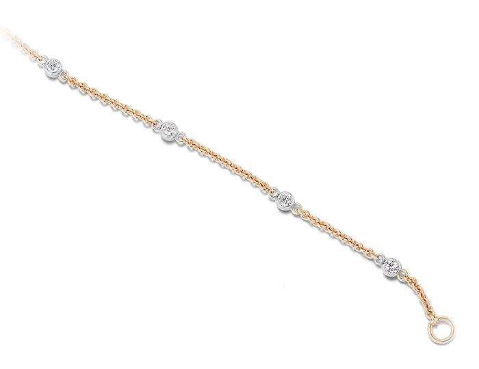 Round brilliant cut diamond bezel bracelet in 18k rose gold with seven diamonds.