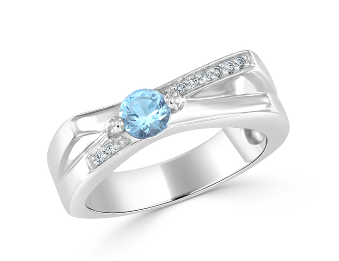 Blue topaz and round brilliant cut diamond ring in 18k white gold.