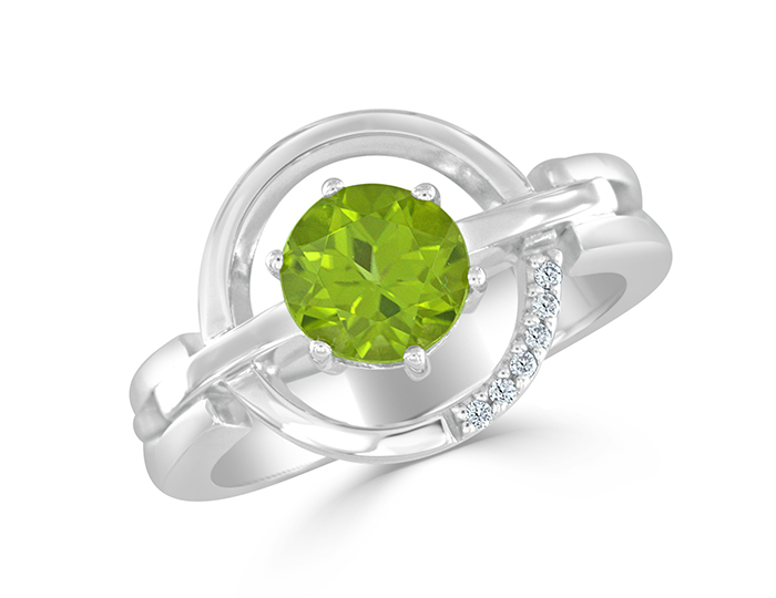 Peridot and round brilliant cut diamond ring in 18k white gold.