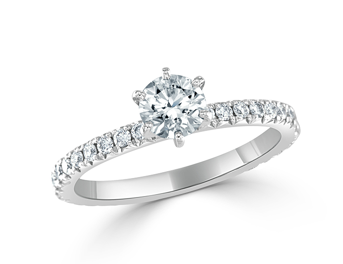 Round brilliant cut diamond ring in 18k white gold.
