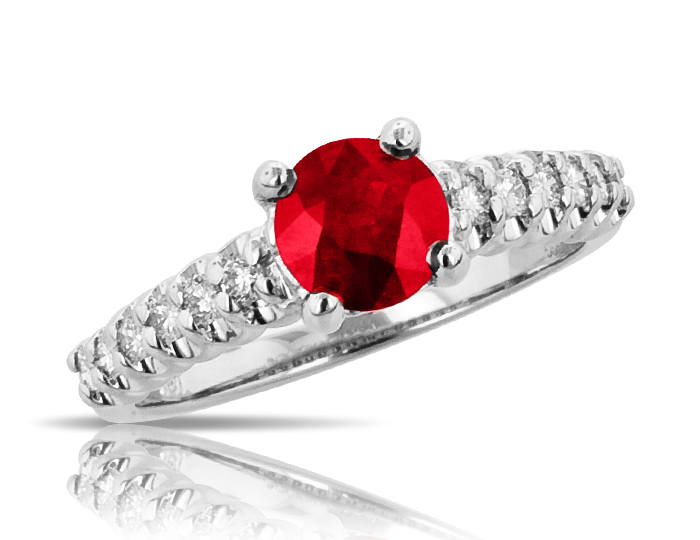 Ruby and round brilliant cut diamond ring in 18k white gold.