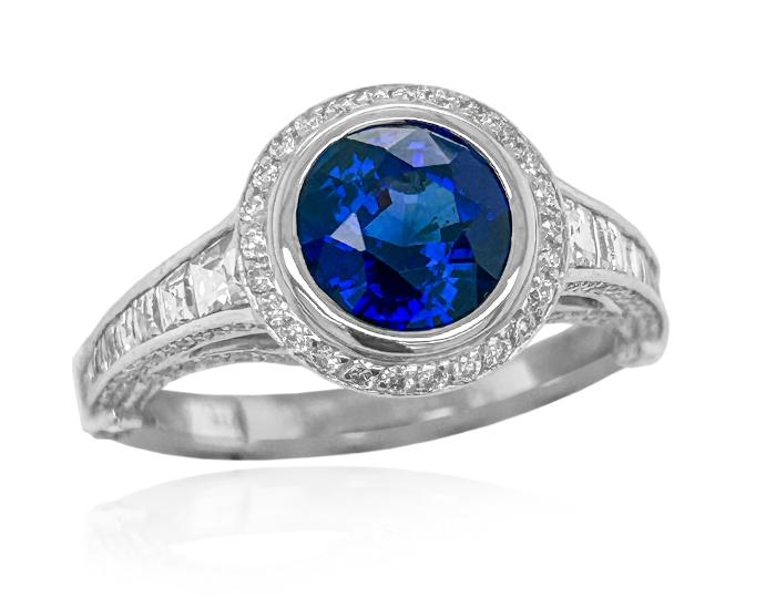 Sapphire and blaze cut diamond and round brilliant cut diamond ring in platinum.