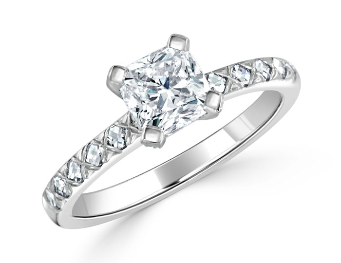 Cushion cut center diamond and blaze cut and round brilliant cut diamond engagement ring in platinum.