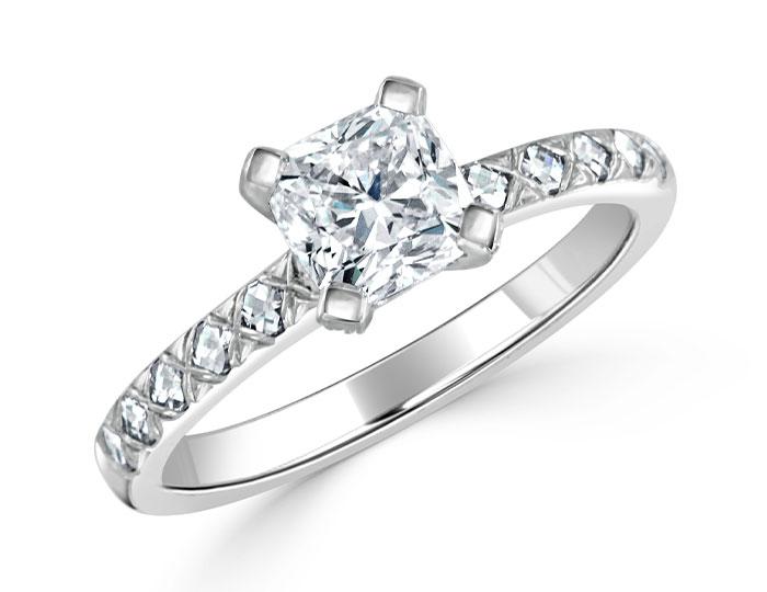 Bez Ambar cushion cut, blaze cut and round brilliant cut diamond engagement ring in platinum.