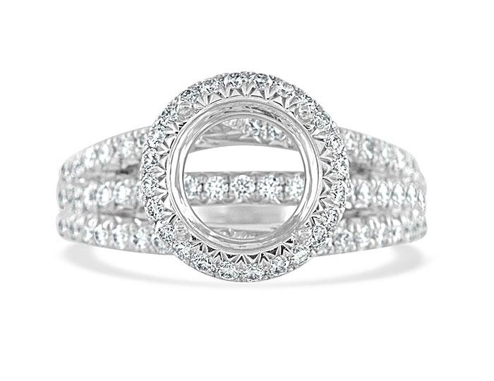 Round brilliant cut diamond engagement ring mounting in platinum.