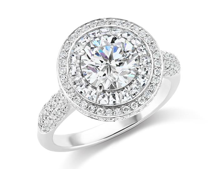 Round brilliant cut and blaze cut diamond engagement ring in platinum.