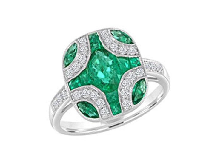 Oval emerald, multi-fancy shape emerald and round brilliant cut diamond ring in 18k white gold.