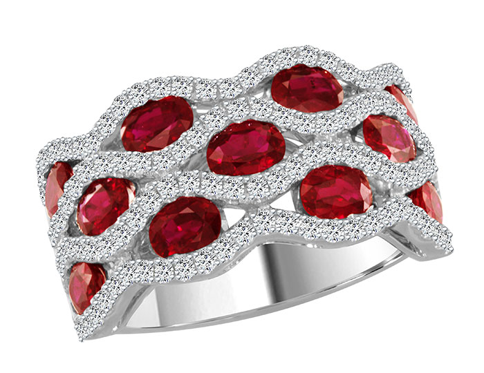 Oval ruby and round brilliant cut diamond ring in 18k white gold.