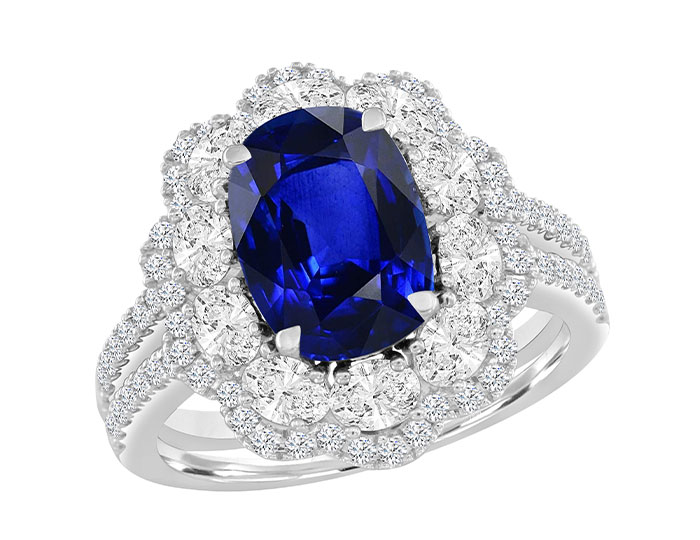 Oval shape sapphire and round brilliant cut diamond ring in 18k white gold.