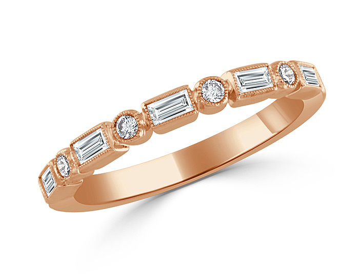 Baguette cut and round brilliant cut diamond band in 18k rose gold.
