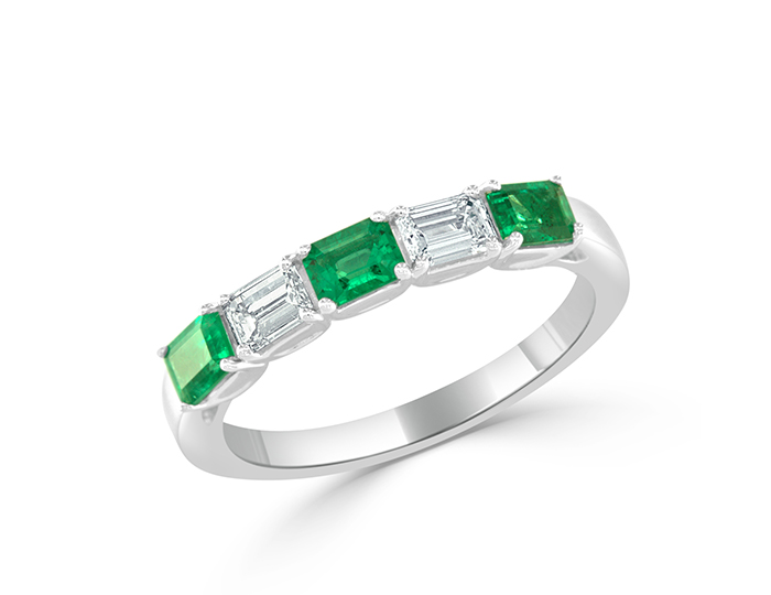 Emerald cut emerald and white diamond ring in 18k white gold.