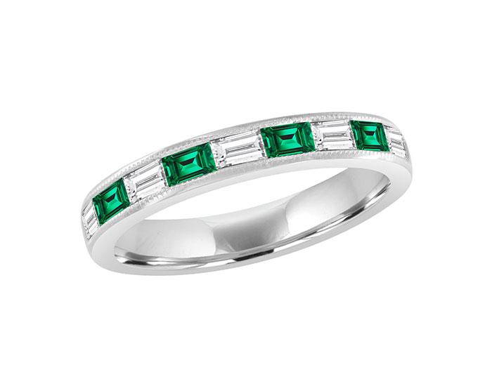 Baguette cut emerald and baguette cut diamond band in 18k white gold.