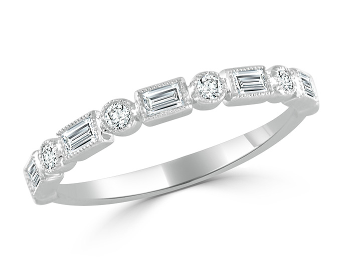 Baguette cut and round brilliant cut diamond band in 18k white gold.