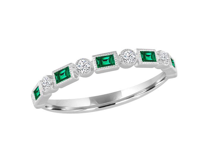 Baguette cut emerald and round brilliant cut diamond band in 18k white gold.