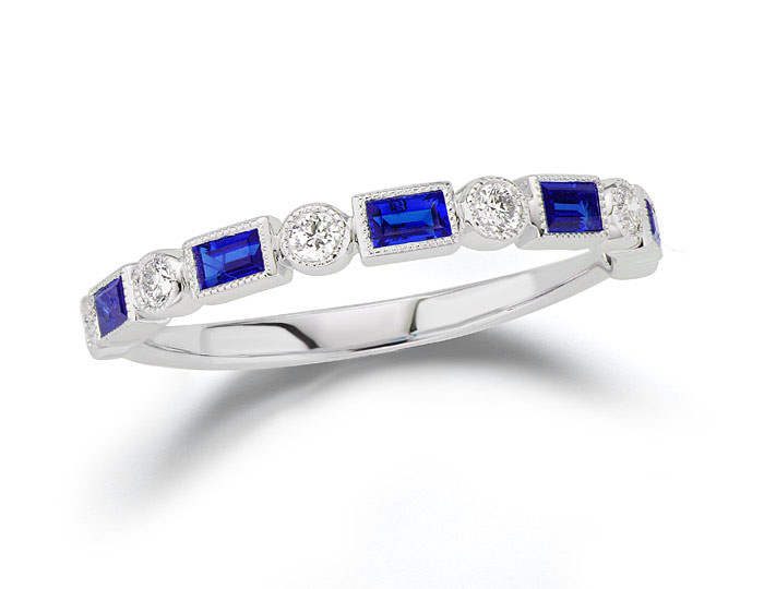 Baguette sapphire and round brilliant cut diamond band in 18k white gold.