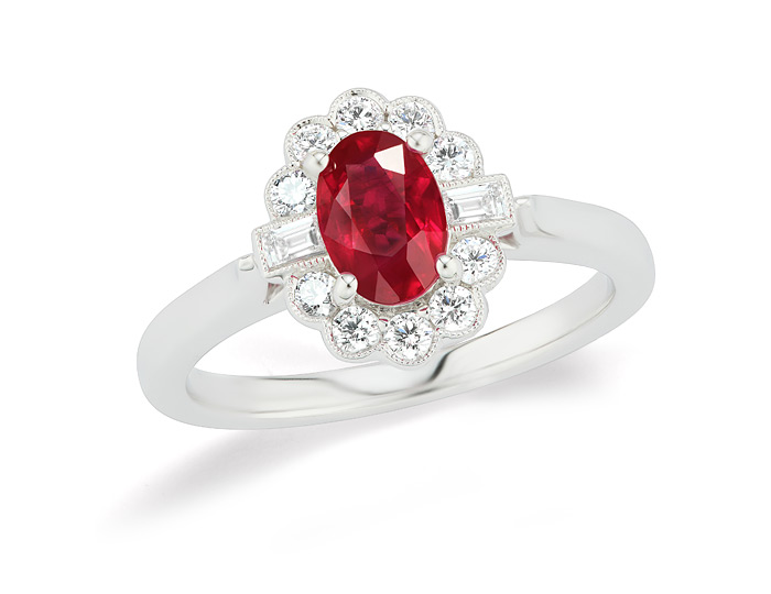 Oval ruby, baguette cut diamond and round brilliant cut diamond ring in 18k white gold.