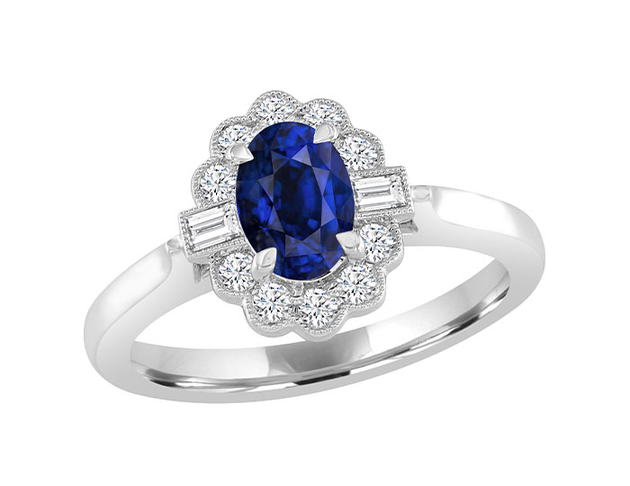 Oval shape sapphire, baguette cut diamond and round brilliant cut diamond ring in 18k white gold.