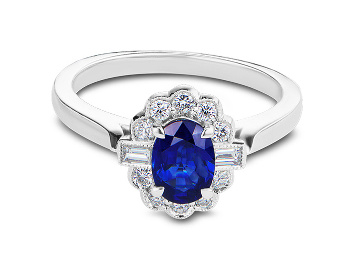 Oval sapphire and round brilliant cut and baguette cut diamond ring in 18k white gold.