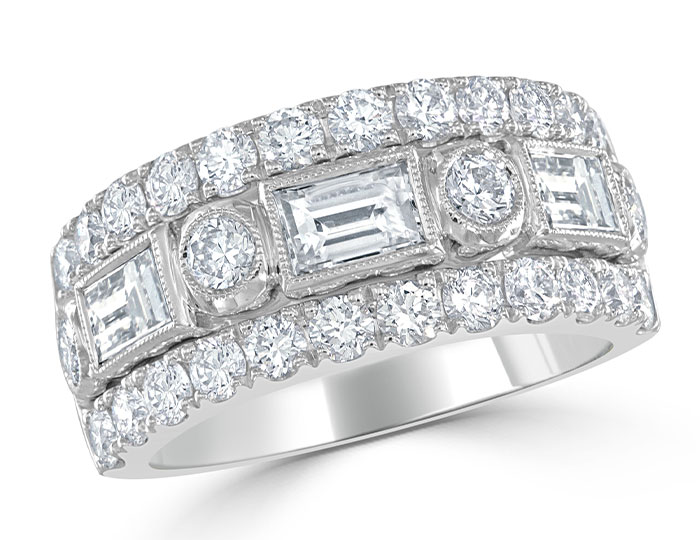 Baguette cut and round brilliant cut diamond ring in 18k white gold.