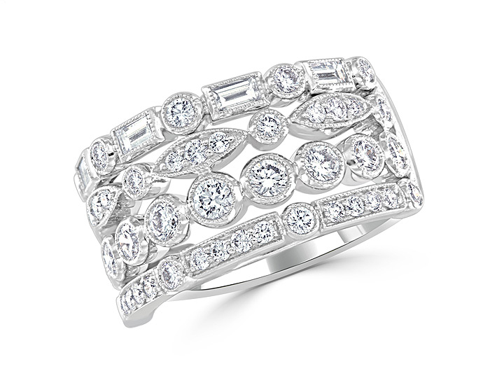 Round brilliant cut and baguette cut diamond ring in 18k white gold.