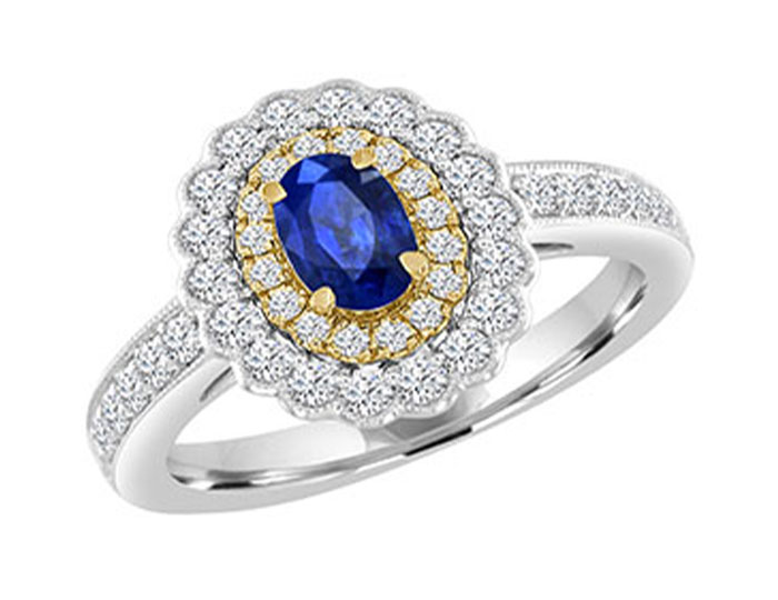 Oval sapphire and round brilliant cut diamond ring in 18k white and yellow gold.